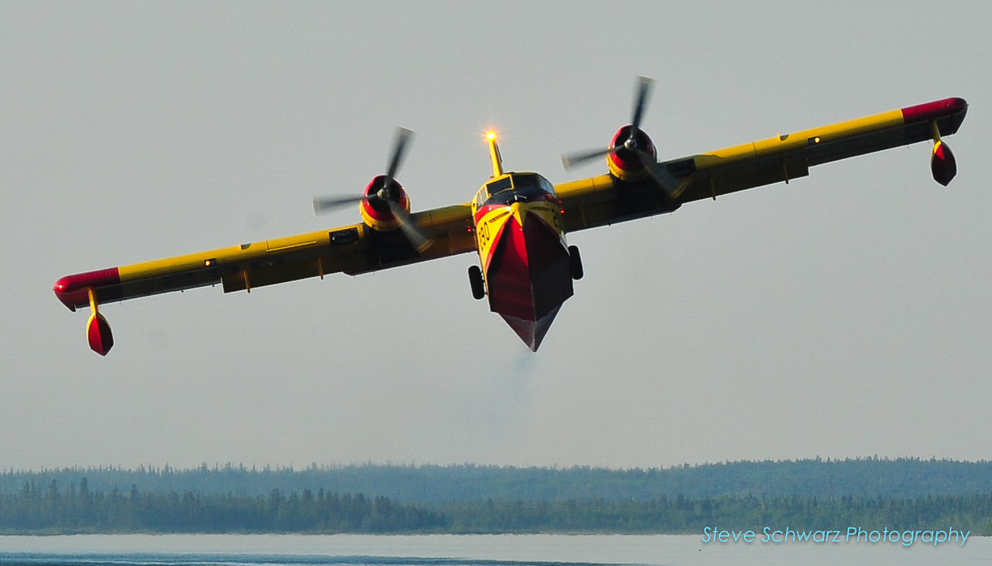 Canadair Cl-215 waterbomber #290 taking off with a full load after scooping up water from Yellowknife Bay.