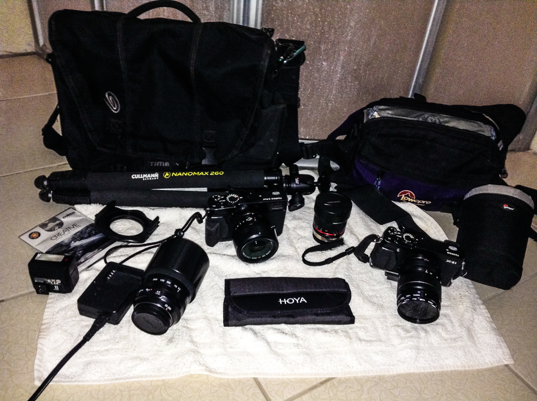 Even with two cameras and three lenses, it is less-than half the size and weight of my Nikon photography gear. I like to travel light.